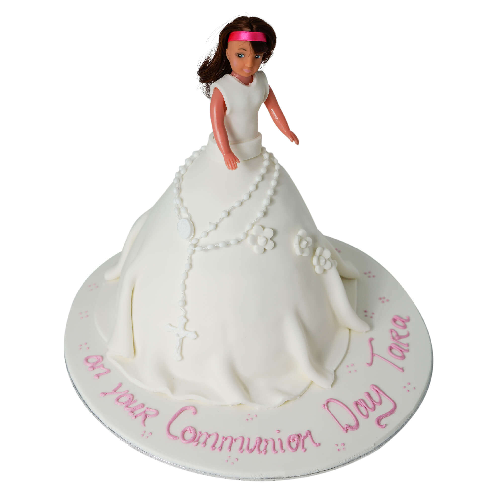 A communion cake in the shape of a girl's doll
