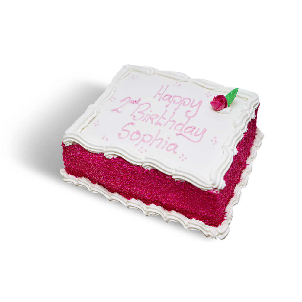 A white birthday cake with pink decorations and writing