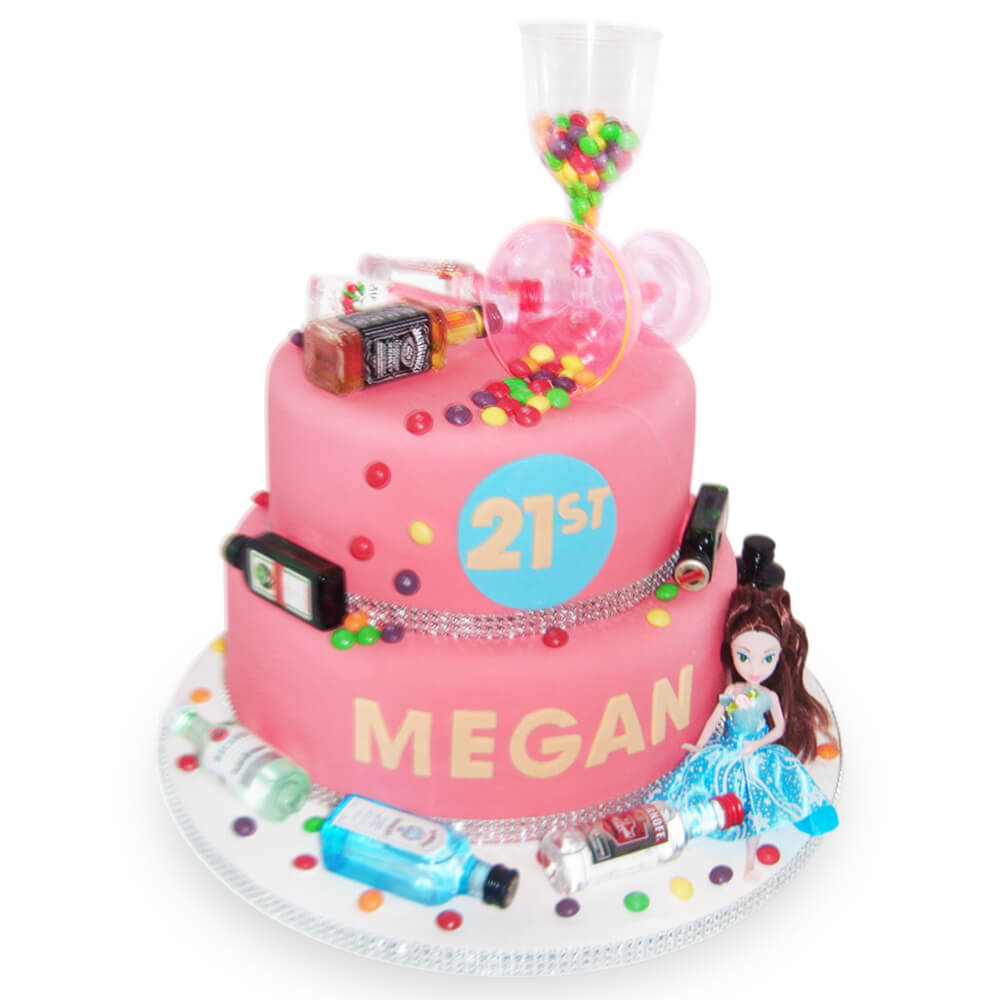 A pink birthday cake with dolls and alcohol bottles