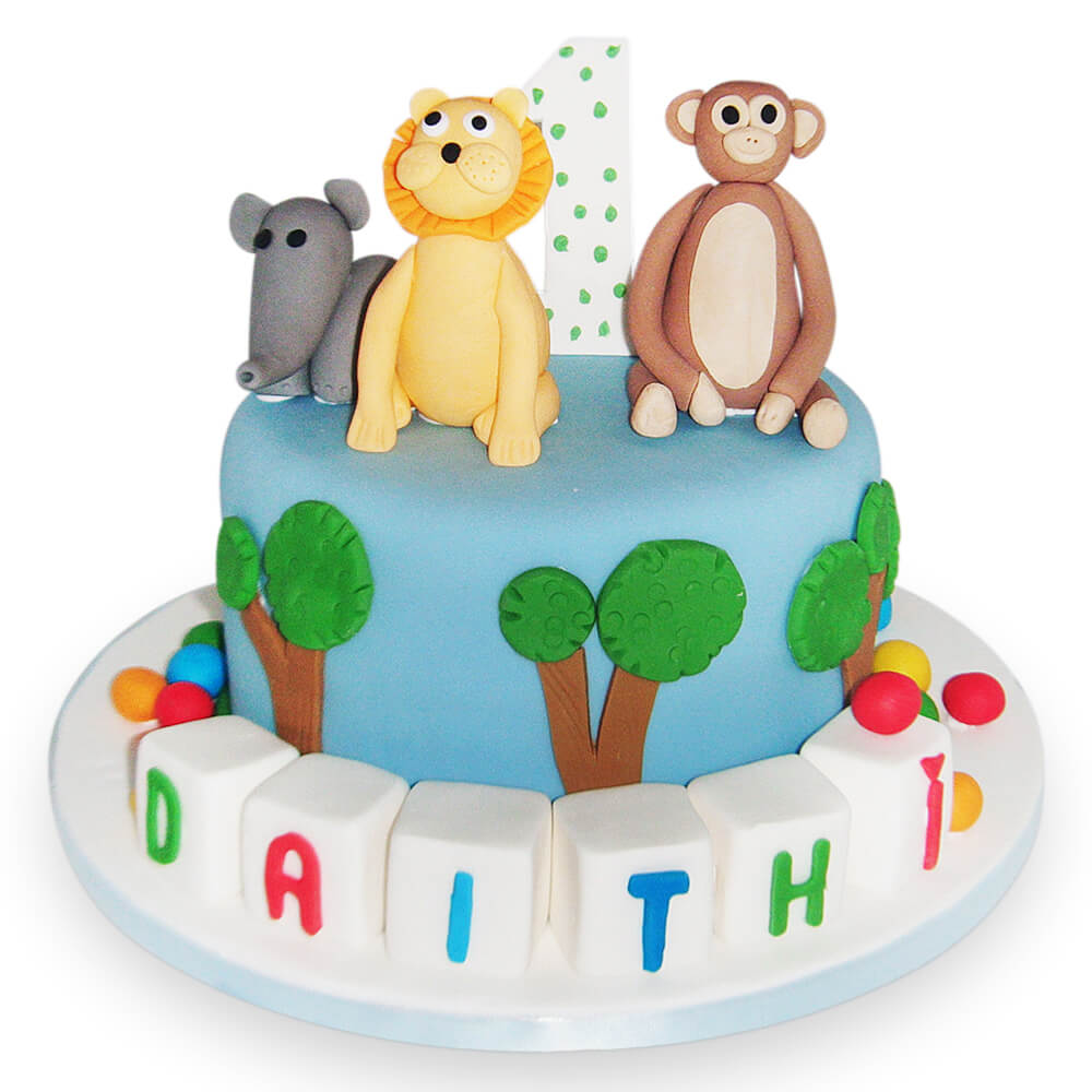 A birthday cake with jungle animals