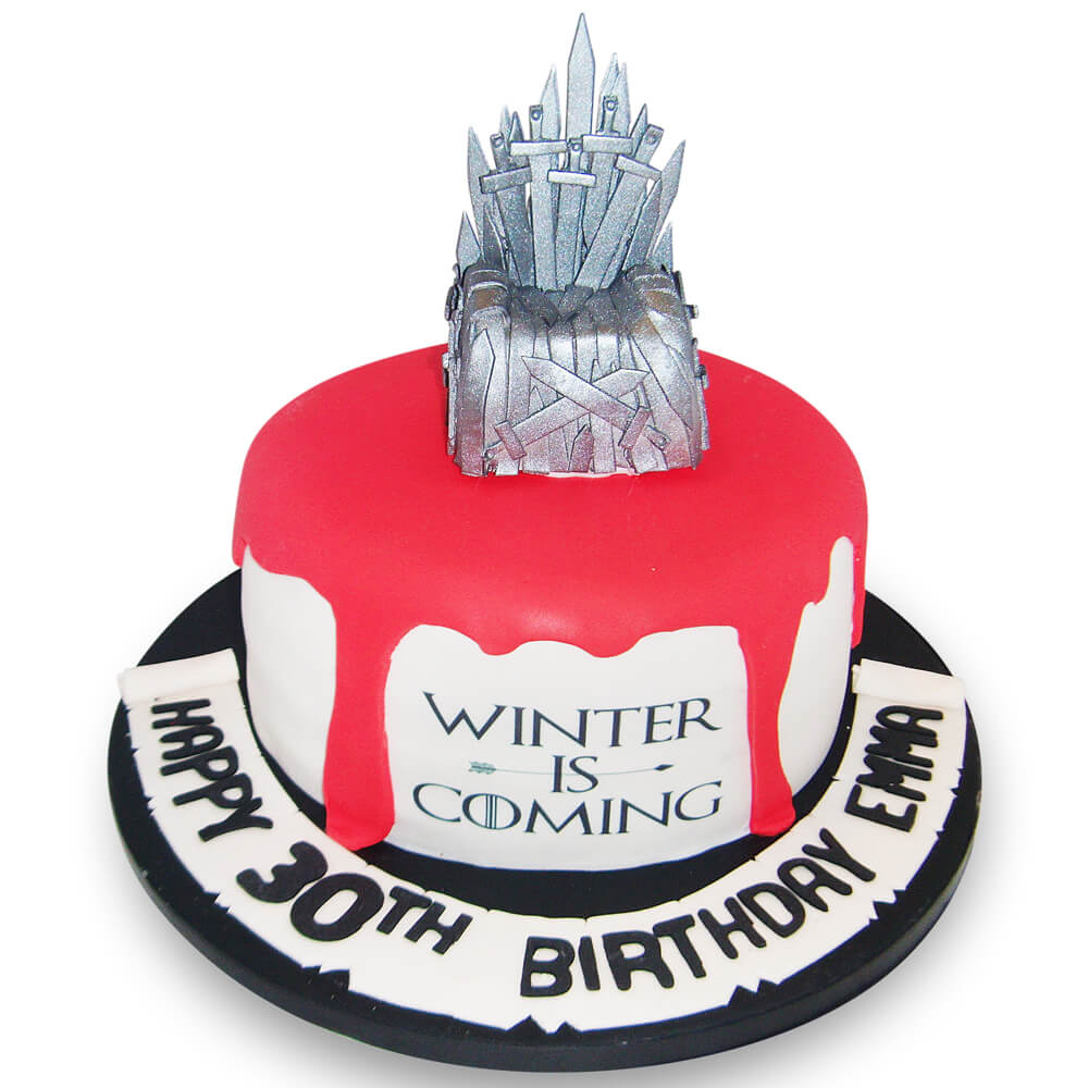 A birthday cake with red blood and a silver throne