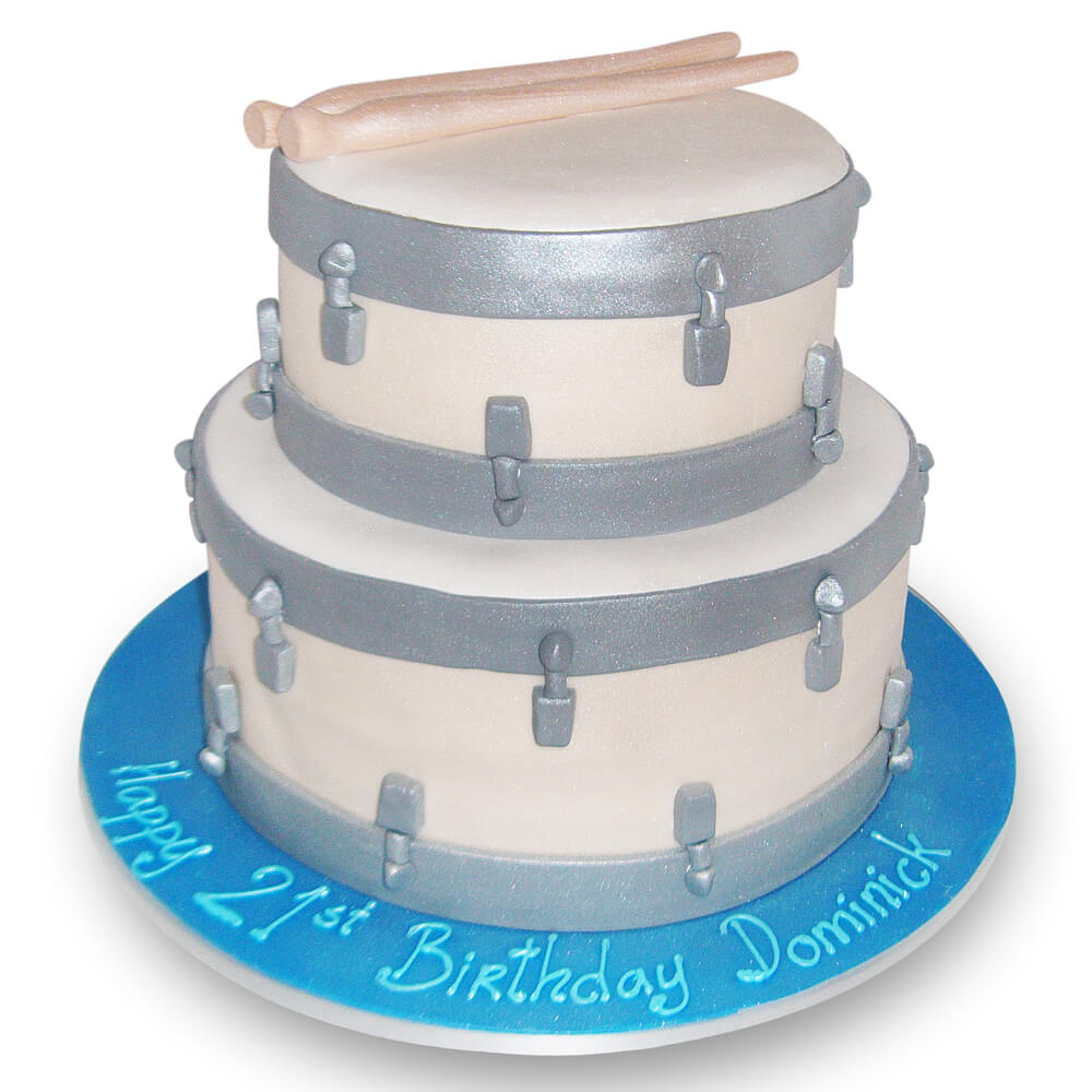 A birthday cake in the shape of drums