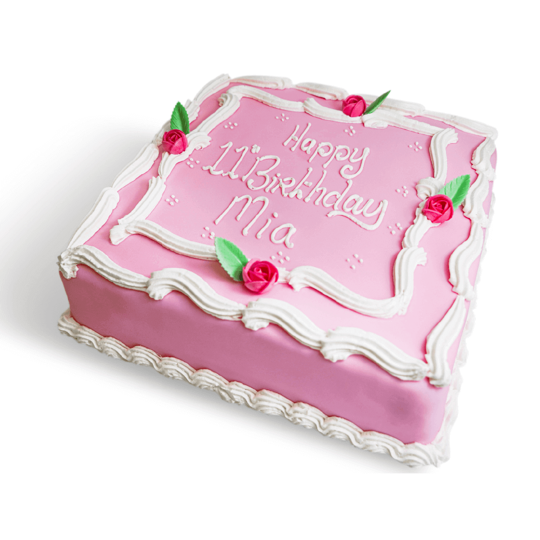 A pink birthday cake with white writing
