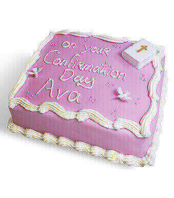 Pink Frosted Cake With 'On Your Confirmation Day' Written In Icing